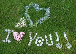 """Love your lawn. Lawn with """"I Love You"""" written in flowers and stones."""
